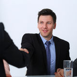 Business people sitting and discussing at business meeting, in office Stock Images