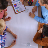 Business people sitting and discussing at business meeting, in office Royalty Free Stock Photography