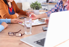 Business people sitting and discussing at meeting, in office Royalty Free Stock Image