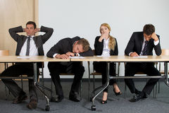 Business people sitting in office Royalty Free Stock Images