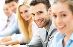 Business people sitting in a row Stock Images