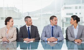 Business people sitting straight talking together Stock Photo