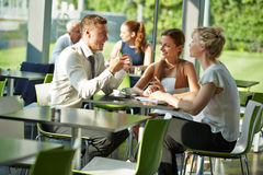 Business people sitting at table for a meeting Royalty Free Stock Photography