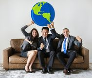 Business people sitting together with icons Royalty Free Stock Image