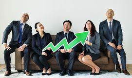 Business people sitting together with statistics icon Royalty Free Stock Photos