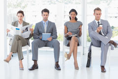 Business people sitting and waiting Royalty Free Stock Photography