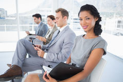 Business people sitting and waiting Royalty Free Stock Photo