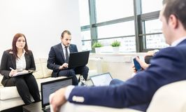 Business people sitting at working meeting in modern corporate office. Royalty Free Stock Images