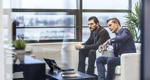 Business people sitting at working meeting in modern corporate office. stock photos