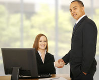 Business People Smile At Camera While Shaking Hand Stock Image