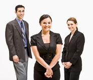 Business people smiling. Portrait of three businesspeople smiling at the camera Stock Image