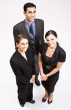 Business people smiling. Three businesspeople smiling at the camera Royalty Free Stock Photography