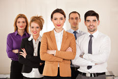 Business people smiling  with arms crossed Stock Photos