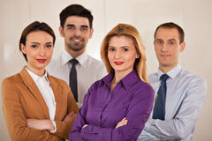 Business people smiling  with arms crossed Royalty Free Stock Photos