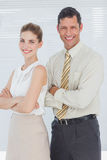 Business people smiling with arms crossed Royalty Free Stock Images