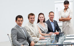Business people smiling at the camera Royalty Free Stock Image
