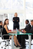 Business people smiling at the camera in a meeting Stock Photography