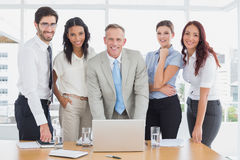 Business people smiling at camera Royalty Free Stock Images