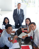 Business people smiling in a meeting stock image