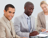 Business People Smiling in a meeting Stock Photos
