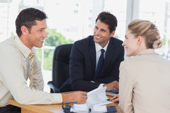 Business people smiling during a meeting Stock Photos