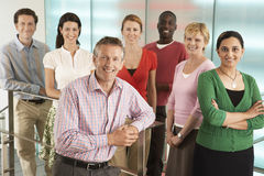 Business People Smiling In Office Stock Photos