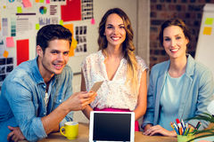 Business people smiling in office Stock Photography