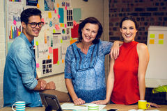 Business people smiling in office Stock Images