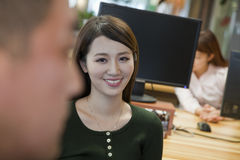Business People Smiling and Working in the Office Stock Photos
