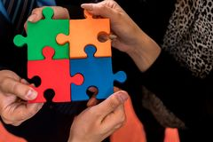 Business people solving jigsaw puzzle. Stock Images