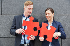 Business people solving jigsaw Royalty Free Stock Image