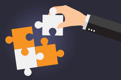 Business people solving oversized jigsaw puzzle together Royalty Free Stock Photography