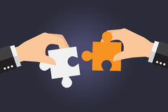 Business people solving oversized jigsaw puzzle together Stock Image