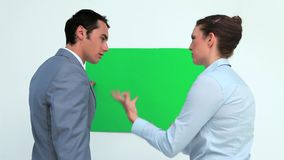 Business people speaking in front of a copy space. In studio stock video footage