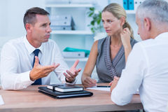Business people speaking at meeting Stock Image