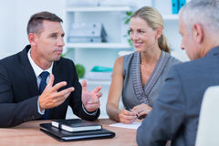 Business people speaking at meeting Royalty Free Stock Image