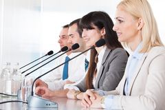 Business People Speaking In Microphone Stock Photos