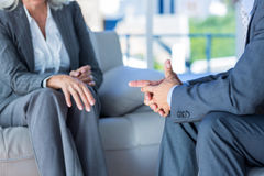 Business people speaking together on couch Royalty Free Stock Photos