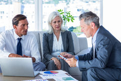 Business people speaking together on couch Royalty Free Stock Images