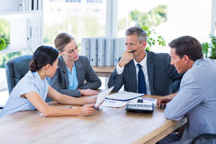 Business people speaking together during meeting Stock Photo