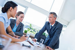 Business people speaking together during meeting Royalty Free Stock Photos