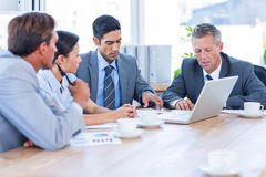Business people speaking together during meeting Stock Image