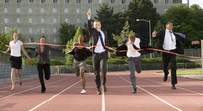 Business People Sprinting Across Finish Line Royalty Free Stock Photos
