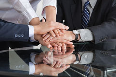 Business people stacking hands. Many business people stacking hands to a pile Stock Photo