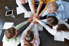 Business people stacking hands as teamwork concept Royalty Free Stock Image