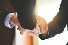Business people Stacking Hands. Business people Stacking Hands together. Unity and teamwork concept Stock Image