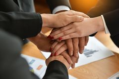 Business people Stacking Hands. High Angle View Of Business people Stacking Hands together. Unity and teamwork concept Royalty Free Stock Images