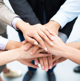 Business people stacking hands. Business people joining hands in circle Royalty Free Stock Images