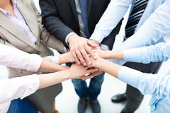 Business people stacking hands. Business people joining hands in circle Stock Photo