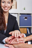 Business people stacking hands for Stock Image